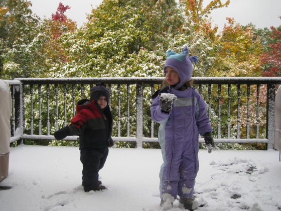 "Ahhhh, Snow in October in the  U.P., circa 2010.  A minute after that picture was taken Molly nailed Joseph with that ""snowball""."
