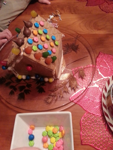 We decorated ginger bread houses, even though I had to sit on my hands as I watched the kids put the candy any old place.  No plan!  No strategy!  No design!  But lots of fun.  Especially the eating part.